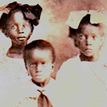 Passport photo of Vera Clarke (right; married name Ifill) with sister Edna and nephew Ernest. Vera immigrated from Barbados in 1921 to join her parents in New York City.