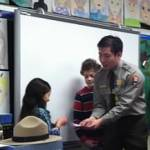 Park ranger works with elementary school students in classroom