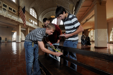 Students Measuring Original Bench in the Great Hall