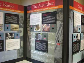 Exhibit Panels from the new Journeys Exhibit (1st Floor Main Building) describing how the Banjo, the Accordian, and song have helped new immigrants and have influenced culture in the United States.