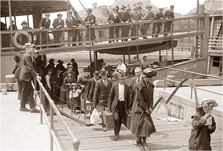 Immigrants disembarking at Ellis Island
