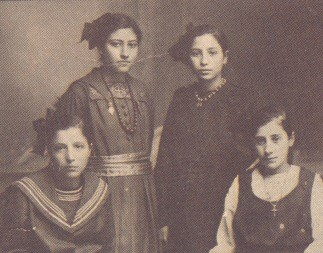 Doukenie, third from left, in 1918 with friends in her home country.