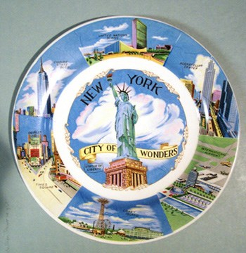 Multi-colored souvenir plate with Statue and other NYC features