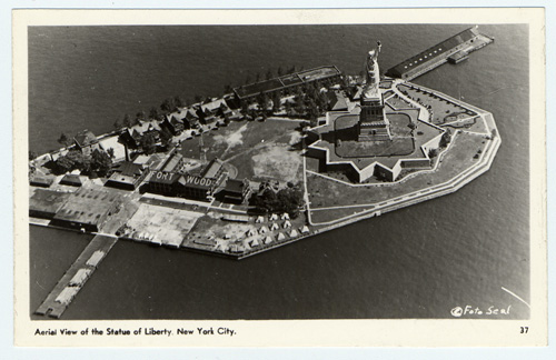 Postcard with aerial view of Liberty Island and Fort Wood c. 1930s
