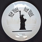 Black-on-white commemorative plate with a silhouette of the Statue of Liberty