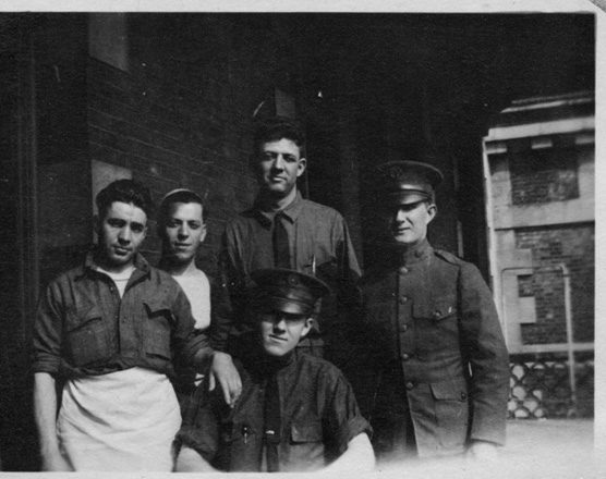 WWI soldiers posed in front of hospital complex c. 1918