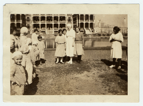 Nurse outside Ellis Island contagious disease ward with patients