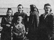 Nelly Ratner (Myers) on the left, next to her mother and sister, on board the Rex.