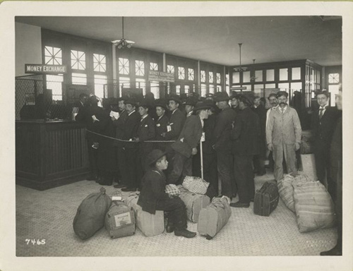 Immigrants Standing in the Railroad Ticketing Office