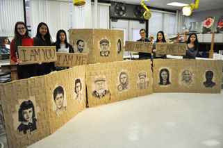 Six Bergen County students stand behind their art pieces