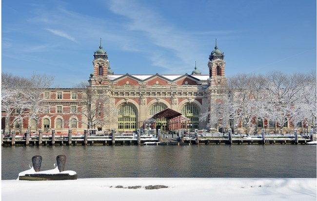 The main building on Ellis Island from the south side of the island. Snow covers the ground.