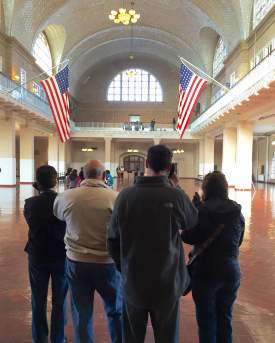 Visitors with audio tour in Great Hall