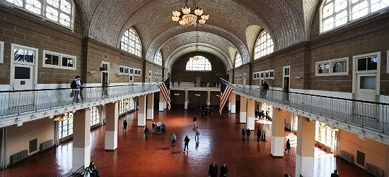 Ellis Island's Great Hall once had lines of immigrants speaking several different languages as they awaited processing. In 1986 it was carefully restored to look as it did a century ago.