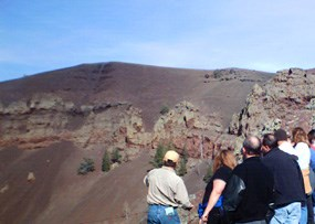 Visitors look into Bandera Volcano.