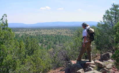A hiker takes in the views from a ridge near El Calderon on the Continental Divide Trail.