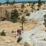 Hikers cross the mesa top on the Headland Trail.