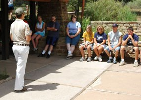 A Student Conservation Association Intern orients a school group to El Morro.