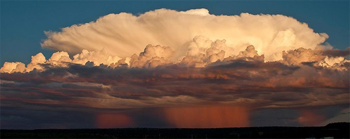 A monsoon storm at sunset