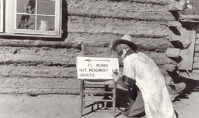 Image of a woman painting a directional sign during the 1930s.