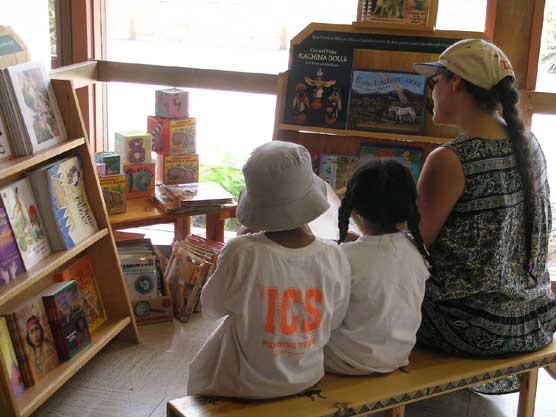 Image of kids and Mom at the kid's corner