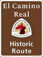 Brown El Camino Real de los Tejas NHT historic route sign with trail logo