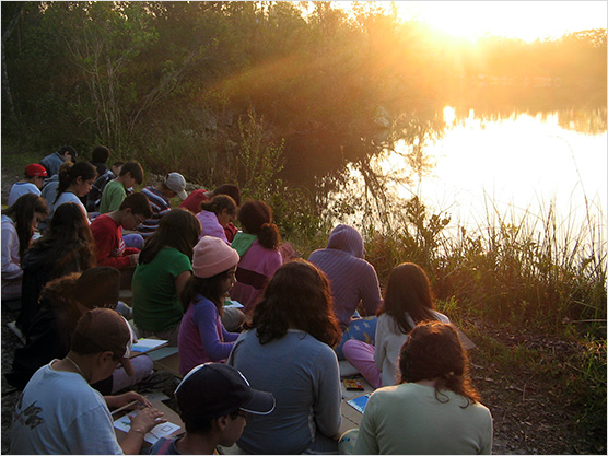 Students reflect on their time at Hidden Lake Camp as the sun rises on their final day of the program.