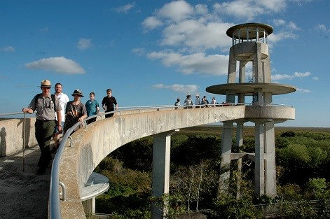 park ranger and students walking down observation tower ramp