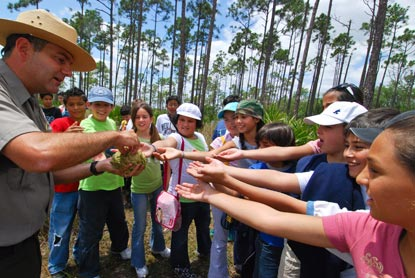 Ranger passing out periphyton to students