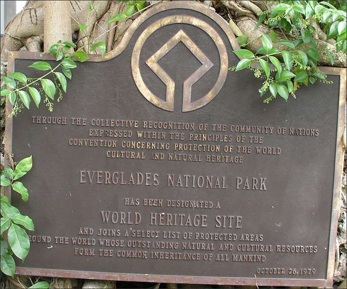 Bronze sign outside of Coe Visitor Center showing the designation of Everglades NP as a World Heritage Site.