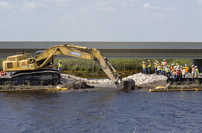 The old Tamiami Trail roadway was broken through