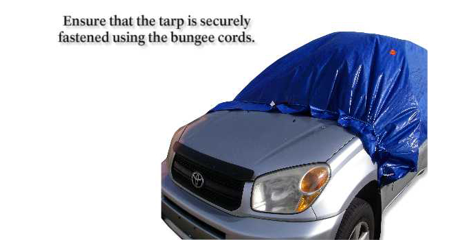 Ensure that the tarp is securely fastened using the bungee cords.