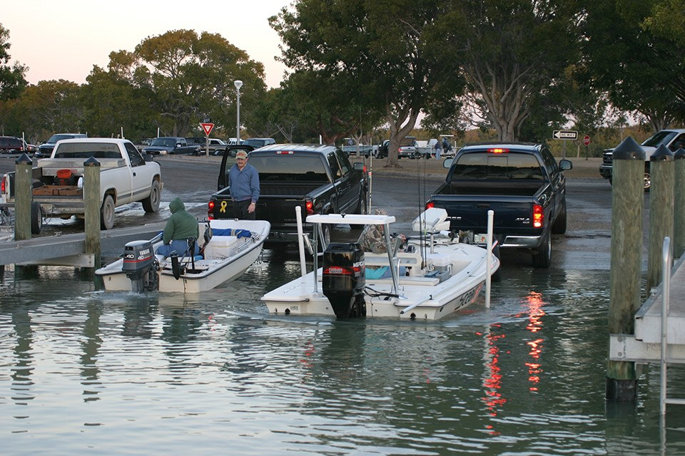 Two boats are being launched at the ramp by the Flamingo marina