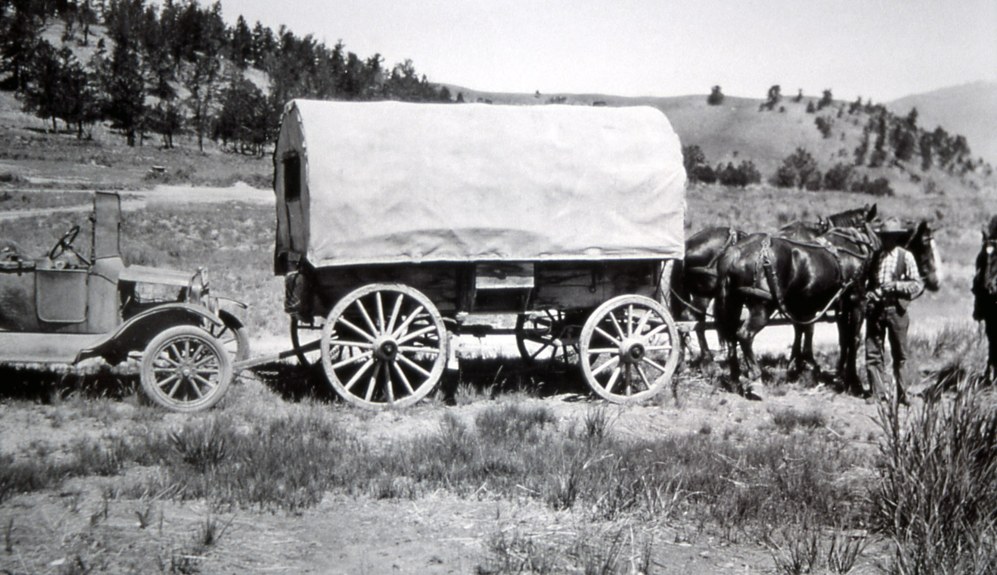 Black White An D Tractor Pulling Wagon : Covered wagon with horses the