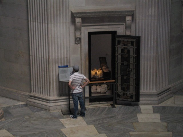 Visitor  near a vault at Federal Hall National Memorial