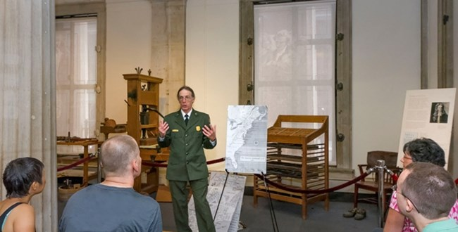 A park ranger conducts a historical program.