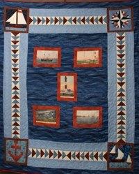 Patchwork quilt with nautical patterns and images.