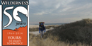 1964-2014 Wilderness 50th Anniversary logo beside winter backpacker on Fire Island