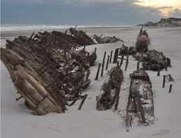 The hull of what is believed to be the wreck of the Bessie White exposed on the beach after Hurricane Sandy.