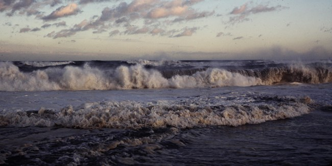 Storm waves crash onshore.