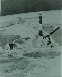 Historic aerial view of Fire Island Light Station and generator building.
