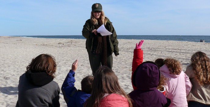 Ranger leading a program with kids on the beach