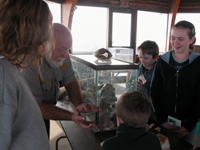 Ranger showing family what's in aquarium.