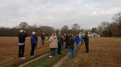 Group of fall birdwatchers on lawn of William Floyd Estate.