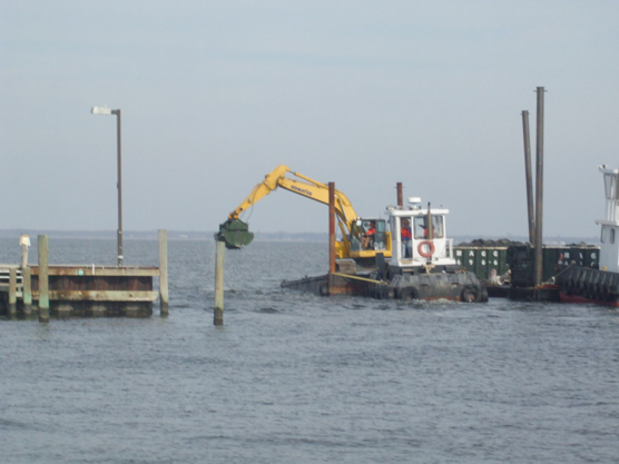 Dredging equipment in marina channel.