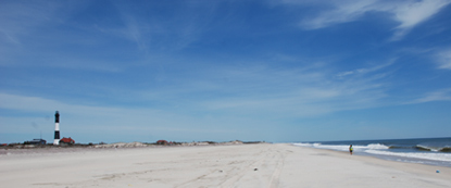 Wide Beach In Front Of Fire Island Lighthouse With Lone Beachcomber