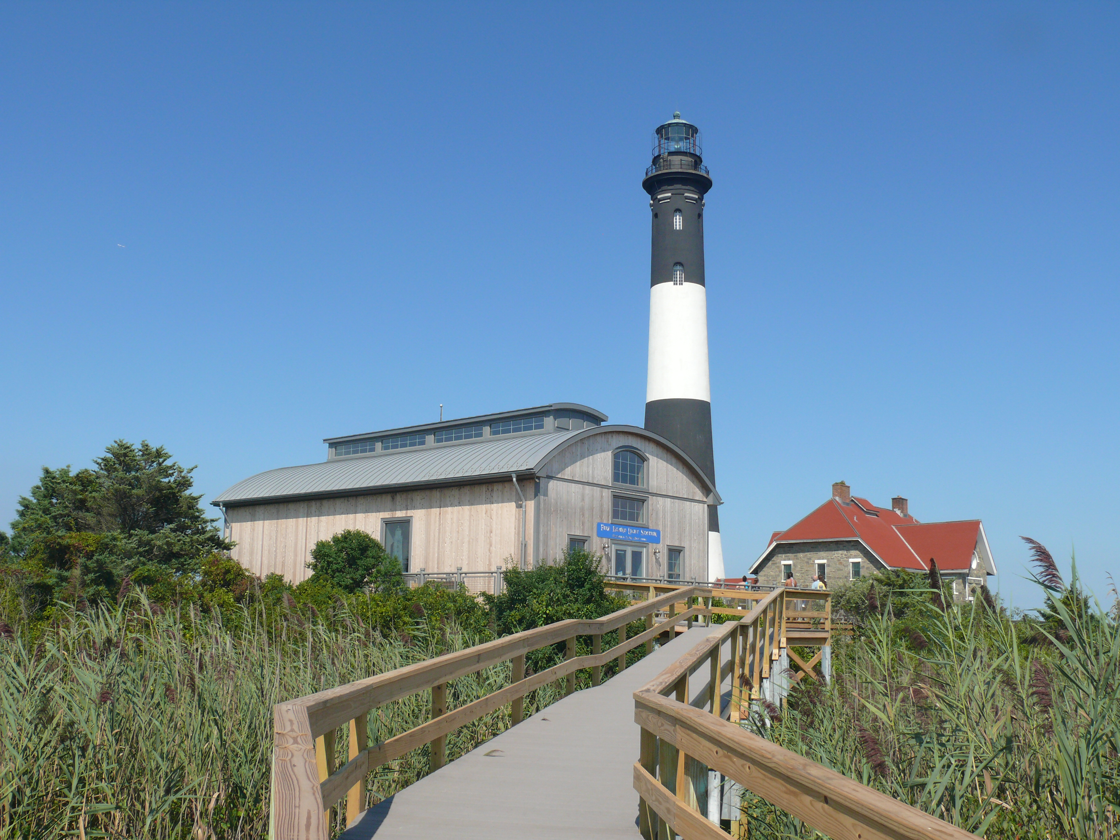 View of Fire Island Lighthouse Fresnel Lens Building from boardwalk
