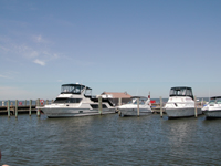 Four boats in slips at Sailors Haven marina.