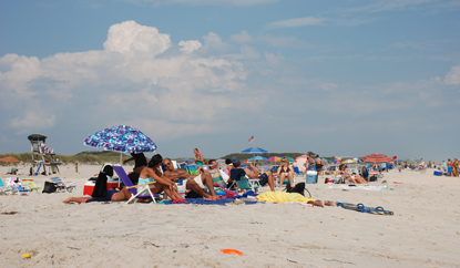 Beachgoers enjoy a summer day at Barrett Beach.