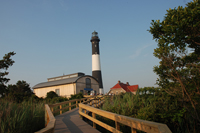 Boardwalk leading to Fresnel Lens Building and Fire Island Lighthouse.