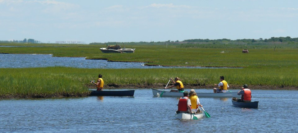 Visitors paddle in the Great South Bay along Fire Island's most extensive salt marsh
